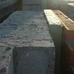 Утеплить стены из керамзитобетонных блоков.